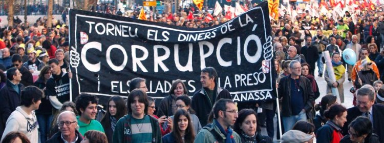 Protesters march during a demonstration against cuts in education, and political corruption in central Valencia